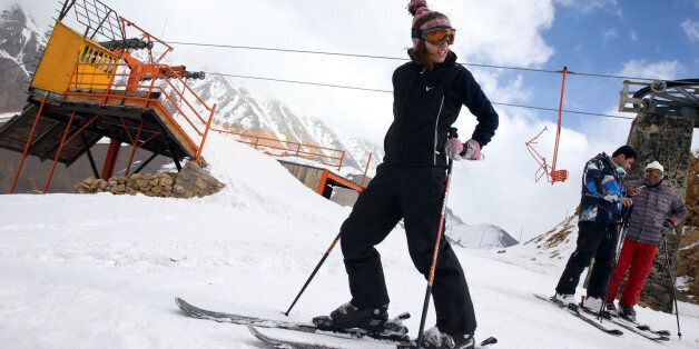 In this Friday, Jan. 16, 2015 photo, a female Iranian skier prepares to descend from a slope at the at...