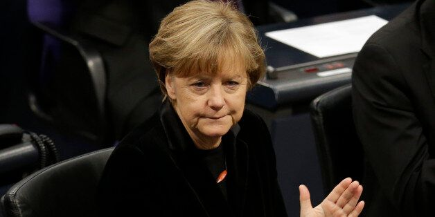 German Chancellor Angela Merkel applauds during a ceremony commemorating the 70th anniversary of the...
