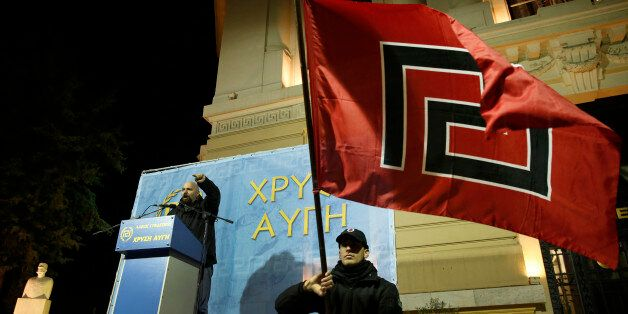 Ilias Panagiotaros, left, a member of the Greek Parliament of the extreme far-right party Golden Dawn,...
