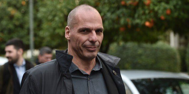 Greece's newly appointed finance minister Yanis Varoufakis walks along a street in Athens on January...