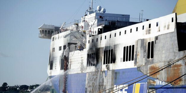 BRINDISI, ITALY - JANUARY 07: The hull of the burned-out ferry 'Norman Atlantic' is cooled by firemen...