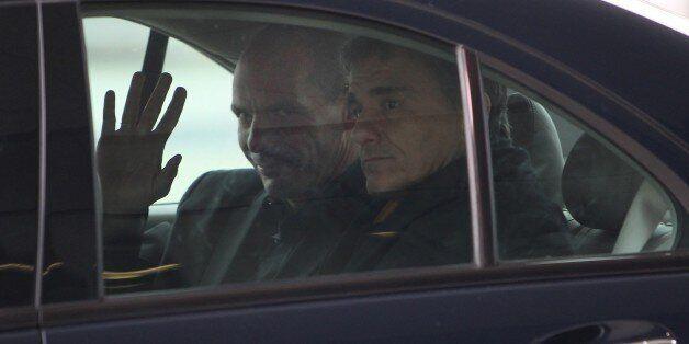 Greek Finance Minister Yanis Varoufakis (L) leaves the European Central Bank (ECB) in Frankfurt am Main,...