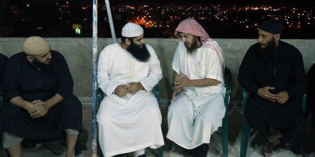 YAJUZ, JORDAN- JUNE 16: Essam Barqawi (2nd from R), known as Abu Mohammad Al Maqdessi, talks with Qatada,...