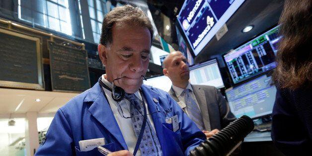 Trader Sal Suarino, left, works on the floor of the New York Stock Exchange Monday, June 2, 2014. U.S....
