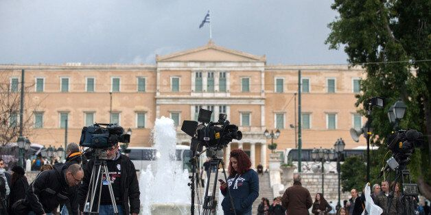 ATHENS, GREECE - JANUARY 25: Media crew set up in front of the Greek Parliament building on January 25,...