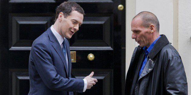 Britain's Finance Minister George Osborne (L) greets Greek Finance Minister Yanis Varoufakis outside...