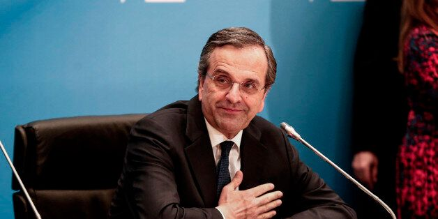 Antonis Samaras, Greece's prime minister, acknowledges his supporters as he makes statements at Zappeion...