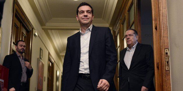 Newly elected Greek Prime Minister Alexis Tsipras (C) arrives on January 28, 2015 for his first cabinet...