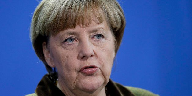 German Chancellor Angela Merkel addresses the media during a joint press conference as part of a meeting...