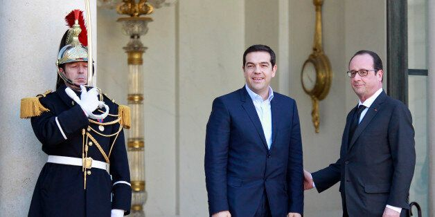 French President Francois Hollande, right, poses with Greek prime minister Alexis Tsipras prior to their...