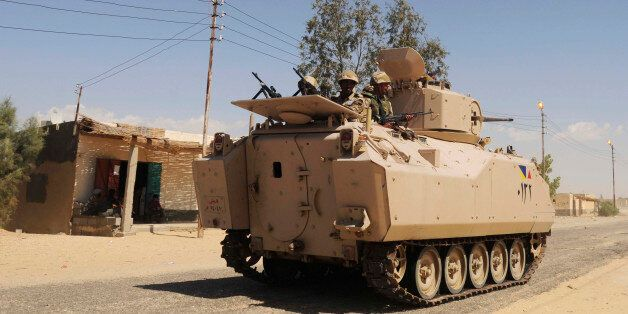 FILE - In this Tuesday, May 12, 2013 file photo, Egyptian Army soldiers patrol in an armored vehicle...