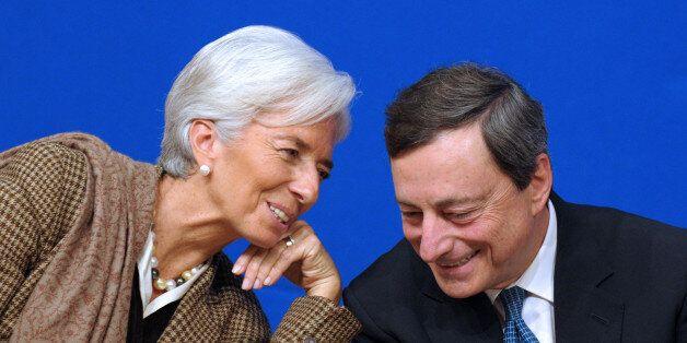 International Monetary Fund (IMF) Managing Director Christine Lagarde talks with European Central Bank...