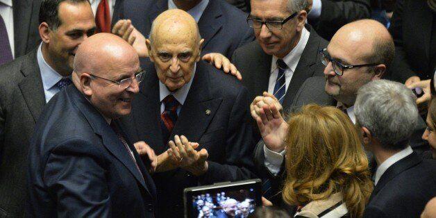 Italy's former President, Giorgio Napolitano (C) surrounded by Italian senators, deputies and representatives...