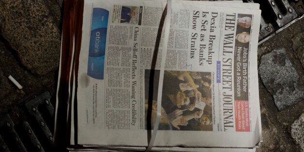 Copies of the European edition of the Wall Street Journal lie on a street in London Wednesday Oct 12...