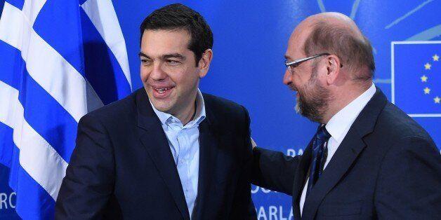European Parliament President Martin Schulz (R) greets Greek Prime Minister Alexis Tsipras on February...