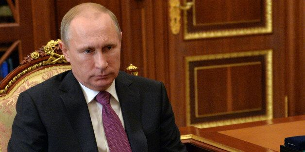 Russian President Vladimir Putin listens during a meeting in Moscow's Kremlin, Russia on Tuesday, Jan....