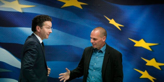 Greece's Finance Minister Yanis Varoufakis, right, reaches out to shake hands with Dutch Finance Minister...