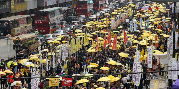 Thousands of pro-democracy activists take part in a democracy march to Central, demanding for universal...