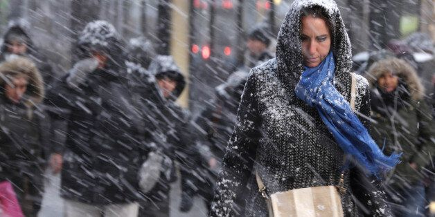 Pedestrians make their way through snow in New York, Monday, Jan. 26, 2015. More than 35 million people...