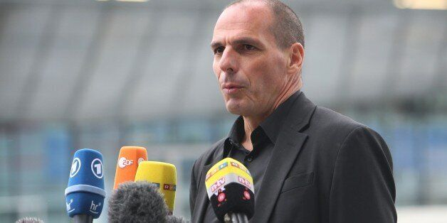 Greek Finance Minister Yanis Varoufakis gives a statement as he leaves the European Central Bank (ECB)...