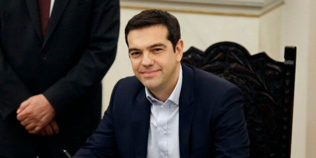 Greece's Prime Minister Alexis Tsipras poses for the photographers after taking a secular oath at the...