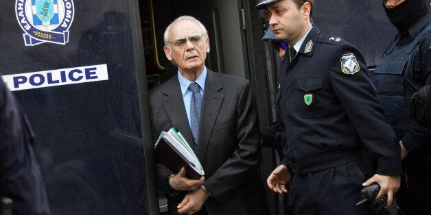 Greek former defence minister, Akis Tsohatzopoulos, arrives for a court trial in Athens on April 22,...