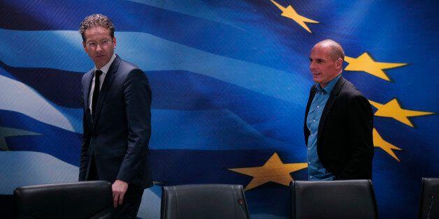 Dutch Finance Minister and Eurogroup President Jeroen Dijsselbloem, left, followed by Greece's Finance...