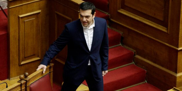 Greece's Prime Minister Alexis Tsipras arrives for the swearing ceremony at the first convention of Parliament...