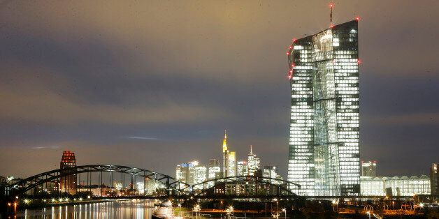 Lights burn in the new headquarters of the European Central Bank in Frankfurt, Germany, Monday, Nov.17,...