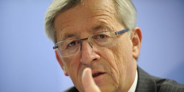 Luxembourg Prime Minister Jean-Claude Juncker gestures during a press conference after an European Council...