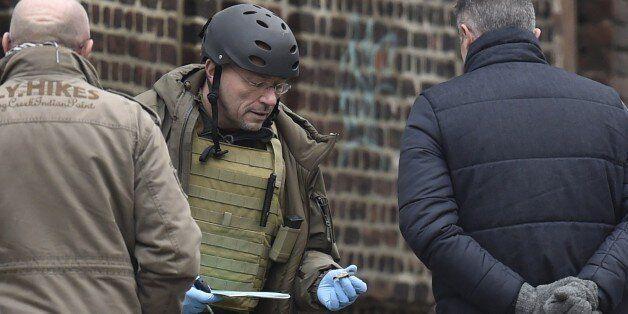 Members of the forensic team work at Colline street in Verviers, eastern Belgium, on January 16, 2015,...