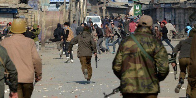 Indian police chase away Kashmiri supporters of the Jammu and Kashmir Liberation Front (JKLF) during...