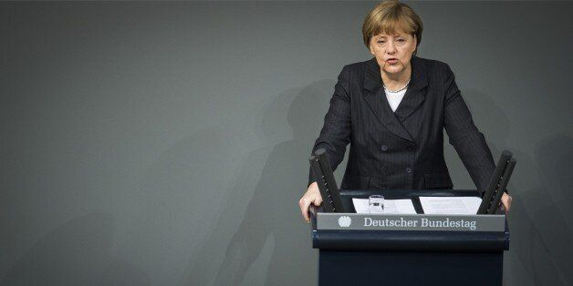 German Chancellor Angela Merkel addresses the members of parliament on the Paris attacks at the Bundestag...