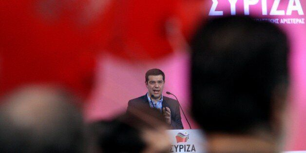 The leader of the Greek Opposition party SYRIZA Alexis Tsipras gestures to supporters during his speech...