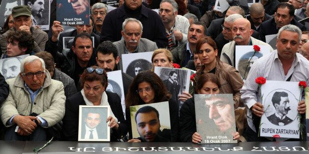 Turkish and Armenian activists gather to protest the killings of Armenians during the last century in...
