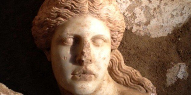 This picture provided by Greece's Culture Ministry on Tuesday, Oct. 21, 2014 shows the broken marble...