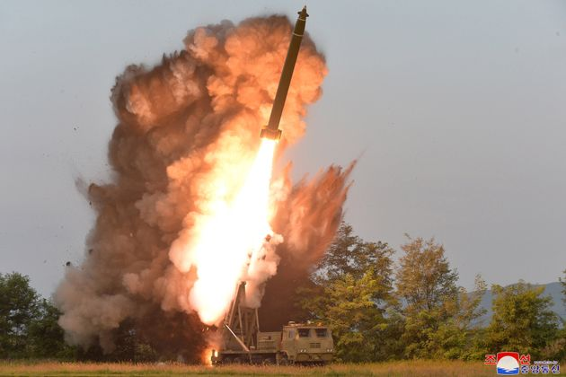 A view shows the testing of a super-large multiple rocket launcher in North Korea, in this undated photo...