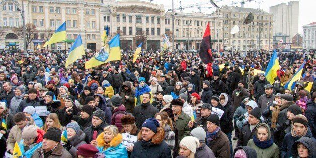 People carry placards reading ''I am Volnovakha' (C) during a rally in the northeastern Ukrainian city...