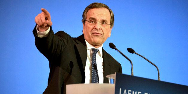 Conservative Prime Minister Antonis Samaras delivers a campaign speech ahead of Sunday's general election,...