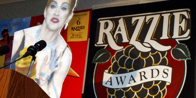 A cardboard cutout of Madonna accepts the award for Worst Actress for her performance