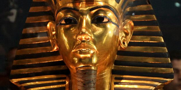 The funeral mask of King Tutankhamun is seen during a tour for the press in the Egyptian Museum in Cairo,...