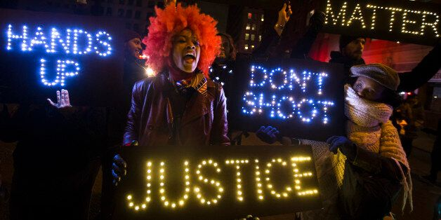 A demonstrator chants during a rally in downtown Manhattan in New York, Saturday, Dec. 13, 2014, during...