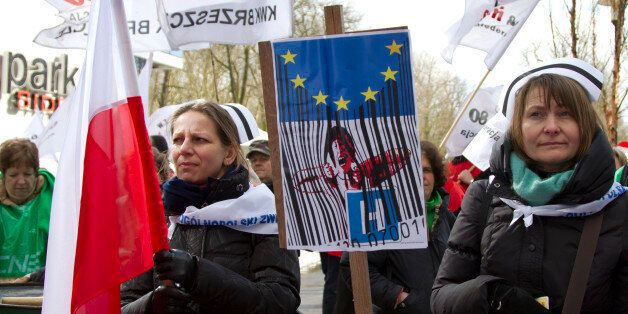 A group of Polish nurses protest against austerity cuts during a demonstration outside of an EU summit...