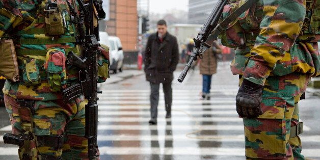 Belgian soldiers patrol in front of EU headquarters in Brussels on Monday, Jan. 19, 2015. Security has...