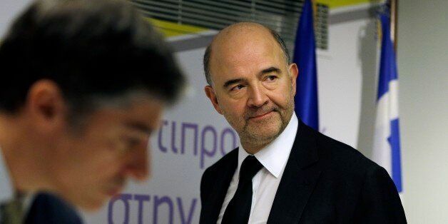 EU Commissioner for Economic and Financial Affairs Pierre Moscovici arrives at a news conference in Athens...