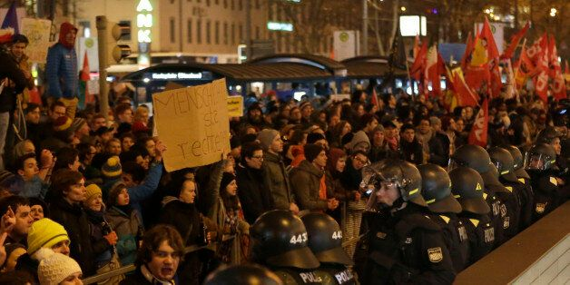 Police block a street during a counter-demonstration against a rally of BAGIDA, the Bavarian section...