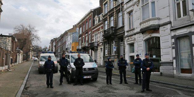 Belgian police officers guard a street in Verviers, Belgium, Friday, Jan. 16, 2015. Police blocks a street...