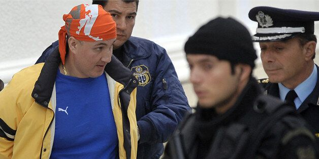 A file picture taken on November 3, 2009 shows Panayotis Vlastos (L) escorted by special police forces...
