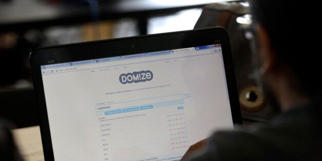 A participant does a search for a domain name during