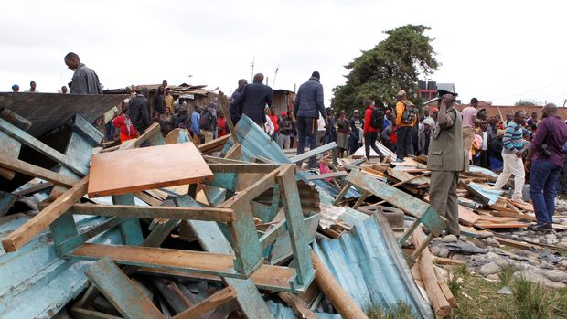A police officer stands near the debris of a collapsed school classroom, in Nairobi, Kenya, September 23, 2019. REUTERS/Njeri Mwangi